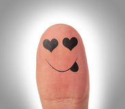 Female thumbs with smile face on the finger Stock Photography