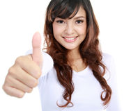 Female thumbs up. Portrait of an attractive young female showing thumbs up. isolated over white background Royalty Free Stock Images