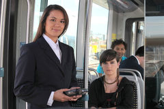 Female ticket inspector. On a tram Stock Photography