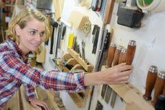 Female tidying up workshop. Female royalty free stock photos