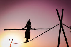Female tight rope walker in India Stock Photo