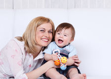Female and toddler laughing Stock Images