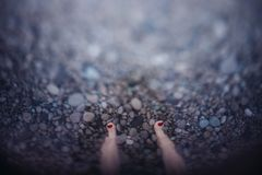 Toes on sea pebbles in the water royalty free stock image