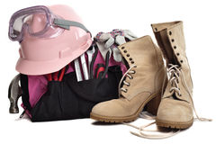 Female Tool Bag. A woman's tool bag. tools, hard hat, goggles and boots. A pink tool bag and pink hard hat royalty free stock photos