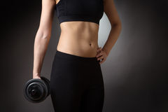 Female torso with dumbell Royalty Free Stock Image