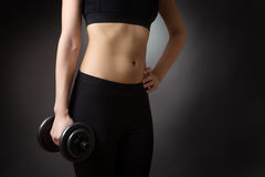Female torso with dumbell Royalty Free Stock Photos