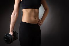 Female torso with dumbell Royalty Free Stock Photography