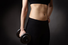Female torso with dumbell Royalty Free Stock Images