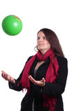 Female tossing a ball Stock Images
