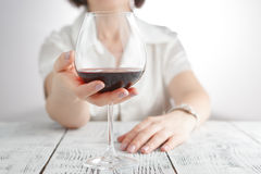 Female touching glass oа red wine Stock Photos
