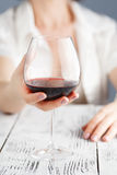 Female touching glass oа red wine Royalty Free Stock Image