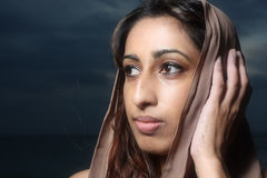Female touching her head Royalty Free Stock Image