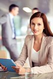 Female with touchpad Royalty Free Stock Photography