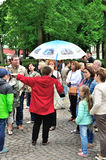 Female tour guide telling and showing tourists something in Peter and Paul Fortress in Saint-Petersburg, Russia Royalty Free Stock Images