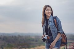 Female tourist with backpack and camera in countryside stock photography