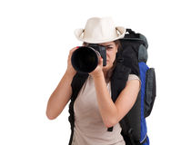 Female  tourist with backpack and digital camera Stock Images