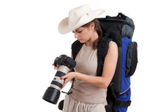 Female tourist with backpack and digital camera Royalty Free Stock Photography