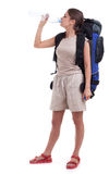 Female tourist with backpack drinking water Stock Photo