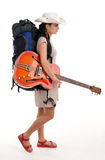 Female tourist with backpack and electric guitar Stock Photos