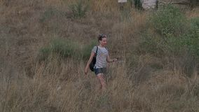 Female tourist with backpack exploring the ancient area stock video footage