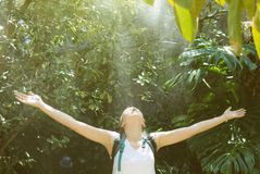 Female tourist with backpack. Female tourist with backpack under the rain in jungle stock image