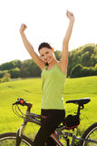 Female tourist with bicycle Royalty Free Stock Image