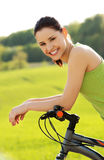 Female tourist with bicycle Stock Photography