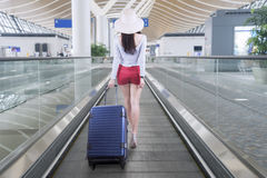Female tourist carrying a suitcase for traveling Royalty Free Stock Photo