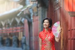 Female Tourist with Chinese Traditional Clothing in Lijiang ,Yunnan, China. Female Tourist with Chinese Traditional Clothing in Lijiang Old town ,Yunnan, China stock photo