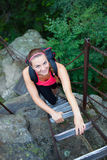 Female tourist climbing the ladder Royalty Free Stock Photo