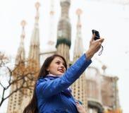 Female tourist with digital camera photographing. Sagrada Familia at Barcelona stock photo