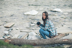 Female tourist with digital camera Royalty Free Stock Photography