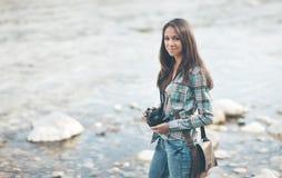 Female tourist with digital camera Stock Photos