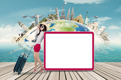 Female tourist and empty billboard Royalty Free Stock Images