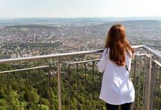 Female tourist enjoying cityscape of Zurich view from Uetliberg,. Switzerland Royalty Free Stock Photo