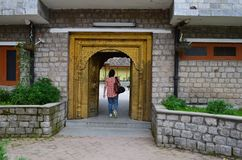 A Female Tourist Entering into Bhimakali temple complex in Sarahan, Himachal, India Stock Photography