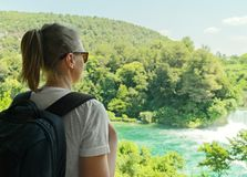 Female tourist. Female tourist with backpack looking at waterfalls stock photos