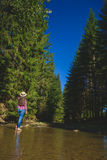Female tourist in the forest resting Stock Photography