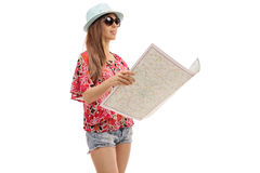 Female tourist with a generic map Royalty Free Stock Images