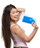Female tourist handing airline ticket. Half-length portrait of female tourist handing airline ticket, isolated on white royalty free stock photography