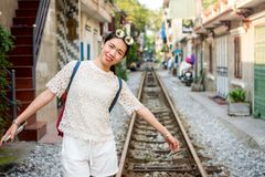Female tourist in the Hanoi train street, Vietnam