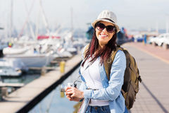 Female tourist at harbour Royalty Free Stock Images