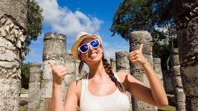 Female tourist having fun at Chichen Itza. Woman having fun at Chichen Itza ruins, Mayan Riviera, Mexico. Female tourist on vacation travel royalty free stock image