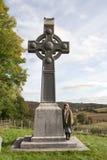 Female tourist at Irish memorial celtic cross Royalty Free Stock Photo