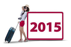 Female tourist leans at number 2015 Stock Image