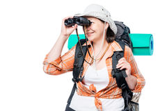 female tourist looking in binoculars on a white Stock Photography