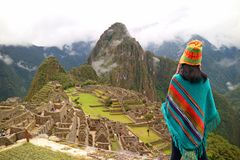 Female tourist looking at the famous ancient Inca ruins of Machu Picchu, Cusco region, Peru. South America stock images