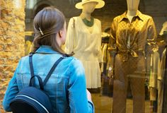 Female tourist looking at the shop window royalty free stock image