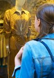 Female tourist looking at the shop window stock photography