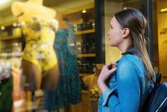 Female tourist looking at the shop window stock photos